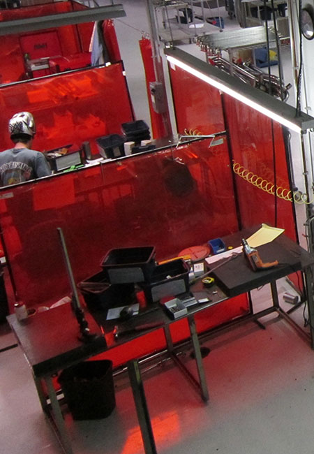 Welding behind red screens
