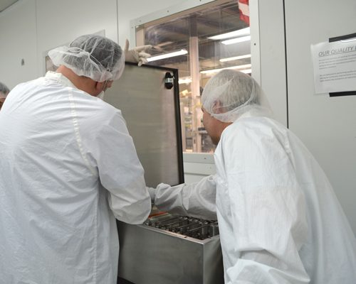 Axenics employees working on clean room