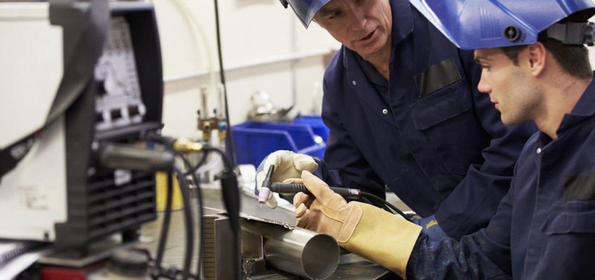 Welding apprentice learning tig welding
