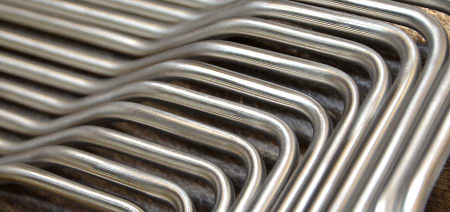 Precision tube bending with metal piping